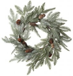 A large overgrown fir foliage wreath with added pinecones and snowy touches