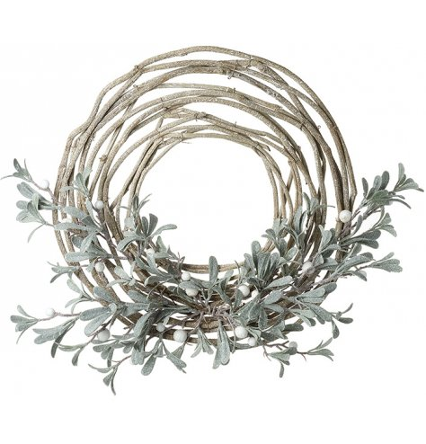 An artificial woven twig wreath decorated with a frosted mistletoe and berry spray