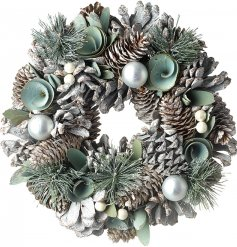 A beautiful Woodland Floor inspired wreath made of up assorted foliage, baubles and leaves