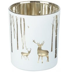 A beautiful white toned glass tlight holder with a silver internal tone and cute woodland scene