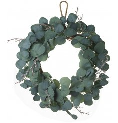 A gorgeously simple green leaf wreath with added glittered twigs