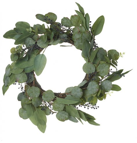 A simplistic round wreath full of artificial leaves and small berries
