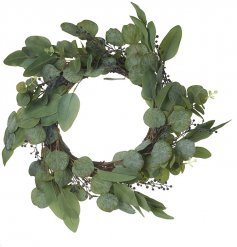 A simple and stylish artificial wreath made up of greenery leaves and small berries