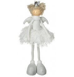 A beautiful standing fabric angel decoration with golden hair, a silver crown and fluffy skirt