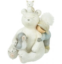 A sweet little sitting polar bear with friends giving him a cuddle, a charming little ornament for the home at Christmas