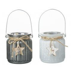 A mix of frosted glass tlight holders both set with a mottled silver decal and hanging wood star feature