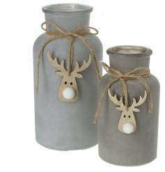 A stylish set of sized glass bottles with grey paint and hanging wooden reindeer charms