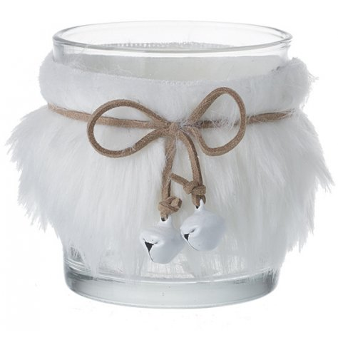 A decorative clear glass candle holder wrapped in a white faux fur coating and tied with a faux leatherette ribbon