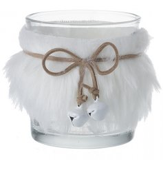 A clear glass candle holder decorated with a white faux fur trimming and jute string bow with bells