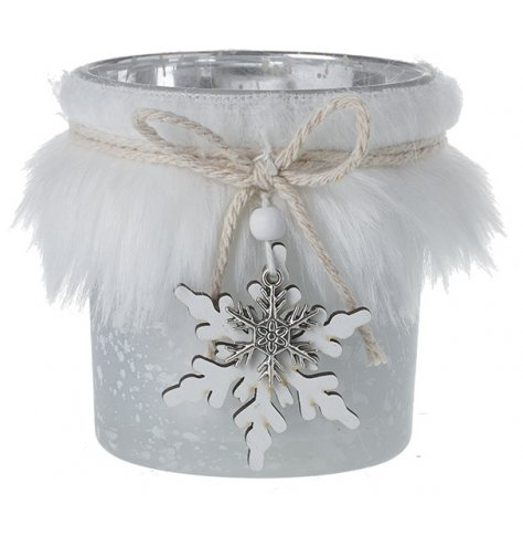A decorative mottled glass candle holder wrapped in a white faux fur trimming and set with a wooden snowflake charm