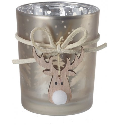A decorative frosted glass candle holder set with a champagne gold print decal and hanging reindeer charm