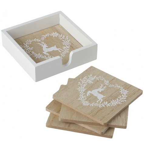 Natural wooden coasters with white reindeer and leaf decal in a holder.