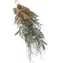 this cluster of artificial foliage, berries and bells will place perfectly in any home