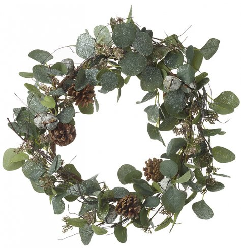 An authentic artificial leaf wreath with pinecones and a sprinkling of festive glitter.