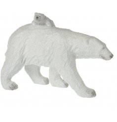 A beautifully simple walking polar bear ornament with an added baby cub riding on the back of it