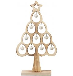 A natural wooden standing tree filled with jingling bells