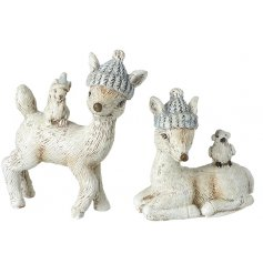 An assortment of posed deer ornaments with festive hats and added friends