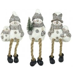 A festive assortment of shelf sitting snowmen with dangly legs and frosty finishes