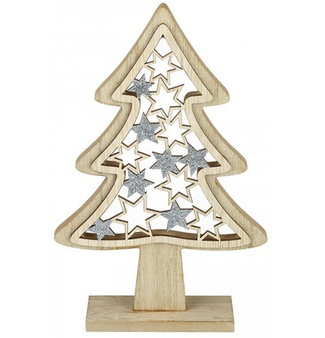 A wooden tree with laser cut stars and silver glitter details