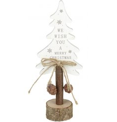 A white wooden slogan Christmas tree with rustic seasonal accessories