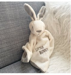 A neutral coloured Little Bunny blanket comforter.