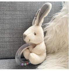 A neutral soft bunny from the Little Bunny range with attached teething ring.