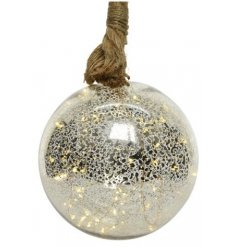 Hung from a chunky rope hanger, this large mottled glass bauble is filled with warm glowing LED string lights