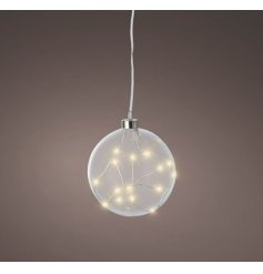A simple hanging glass bauble filled with warm glowing LED lights