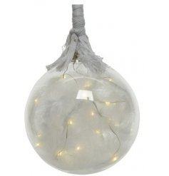 A beautiful hanging glass bauble filled with warm glowing LED lights and faux feathers