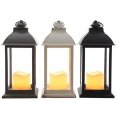 An assortment of 3 different coloured LED Lanterns with flickering candles in each