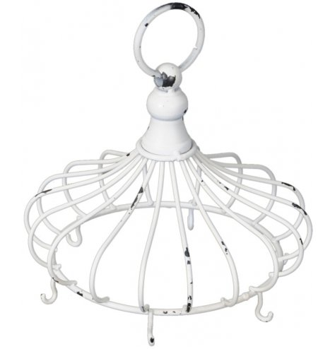 A metal wire crown shaped set of hooks in a distressed white finish. A perfect display piece for individual items such a