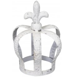 A decorative metal crown with a ridged hammered decal and distressed white washed colour