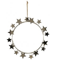 A silver toned metal wreath covered with assorted sized stars