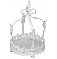 A decorative metal crown with a distressed white tone to it