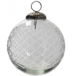 A diamond pattern etched glass bauble with a tarnished ring topper