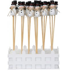 Perfect for adding to floral bouquets at Christmas Time, a wooden snowman on a stick