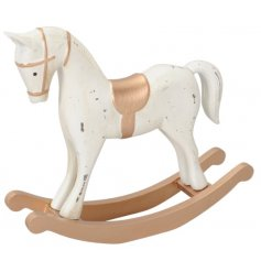 A decorative wooden rocking horse covered with a Rustic White Washed tone and golden trim