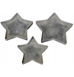 A mix sized set of star shaped metal trays each decorated with a distressed white washed finish and ridged edge