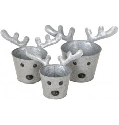 An assorted sized set of zinc planters each complete with cute reindeer decals and a hammered zinc effect