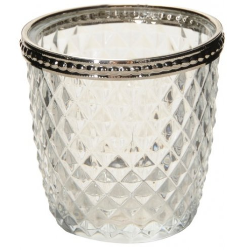 A beautiful vintage inspired glass t-light holder with decorative cut glass and a patterned silver rim.