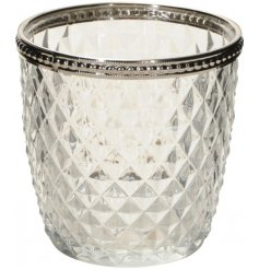 A clear tlight holder decorated with diamond ridged decal and silver beaded trim