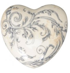 A vintage inspired decorative stoneware heart covered with a sleek crackled glaze and spiral pattern