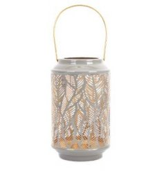 Part of an enchanting new range of homewares and accessories, a grey toned lantern with a feather cut detail
