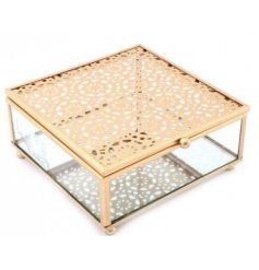 Sure to bring a Golden Luxe accent to any home space, a square glass jewellery box with an added mirrored base and glass