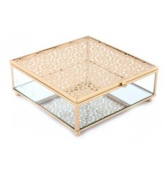 A sleek glass jewellery box with an added mirror base and gold cut detailing top
