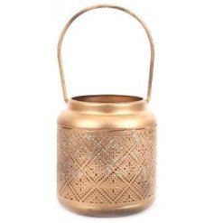 A small metal lantern featuring a golden tone and added intricate cut detailing