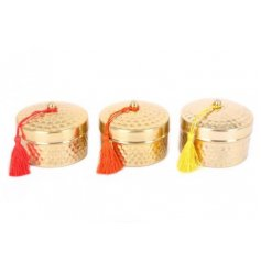 this assortment of 3 hammered gold candle pots with added coloured tassels
