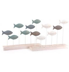 An assortment of swimming fish on a natural wooden block base