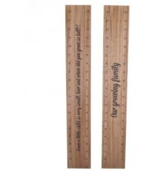 A mix of natural wooden height charts with scripted text decals
