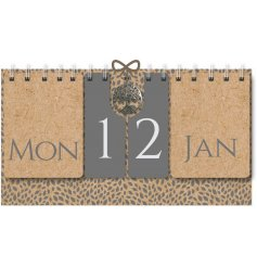 A natural toned flip calendar set with added grey tones and a silver tree hanging charm to finish